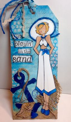 Mixed media tag with Julie Nutting's beach themed dolls. Anchor and ric rac are Target dollar bin finds.