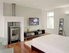 Compact gas woodstove in the bedroom