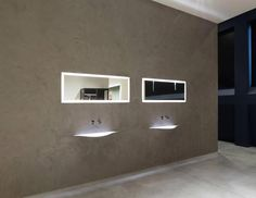 Stores Antonio Lupi opens its new showroom: Antoniolupi showroom | As soon as you enter the garden, you are greeted by the impressive VascaBarca, a Stone Grey marble sculpture designed