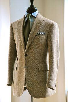 manolocostanewyork:    Antiqued tan Herringbone Sport Jacket, Notch, Ticket/Flap Pockets. Linen/ Silk Blend. Med Blue Soft Plaid Poplin Shirt. Navy/Cream and Green Pocket Square, Hand Rolled In Japan.  Hand Made by Manolo Costa, New York