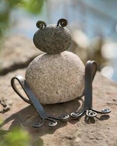 A frog out of rocks and bent metal.