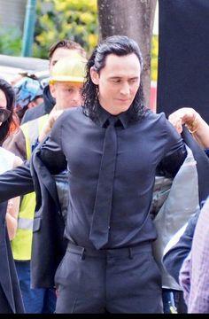 Tom dressing in his suit as Loki