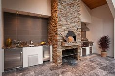 Beautiful #outdoor #kitchen with partial roof to protect the appliances. Check more at www.rhodeislandhomes.com