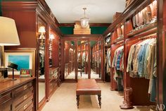 The closet at the Bedford, New York, home of Ralph Lauren is outfitted with mahogany millwork, giving the room the refined air of an English estate.