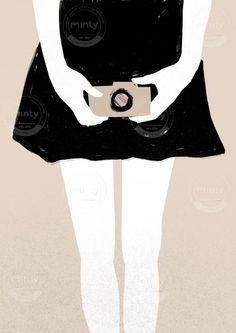 Girl holding a camera via mintystock.com