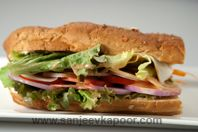 A delicious foot long sandwich, filled with all vegetables.