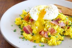 "Soft Boiled Egg and Bacon on Cauliflower ""Couscous"" Cauliflower couscous topped with a soft-boiled egg and crispy bacon brings lots of beneficial fats and flavor to the perfect breakfast."