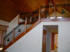 maple wood stairs with a rustic metal railing