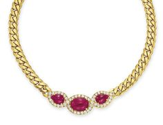 A RUBY, DIAMOND AND GOLD NECKLACE, BY BVLGARI   Set at the front with three cabochon rubies within a circular-cut diamond surround, to the 18k gold link neckchain, mounted in 18k gold, 15½ ins.  Signed BVLGARI, Italy