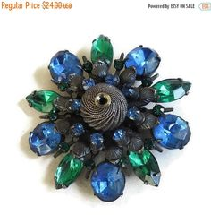 """❘❘❙❙❚❚ CIJ SALE ❚❚❙❙❘❘   This is a gorgeous Emerald Green and Blue Rhinestones Brooch Vintage with Gun Metal Finish Leaves & Spiral Ball!  This brooch measures 2 1/8"""" hig... #teamlove #ecochic #vogueteam"""