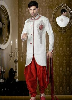 Feminine banarasi white colored designer sherwani is designed with sequins work, zarkan work, stone, beads and heavy zardosi work all synchronized effectively with the pattern and style and design of ...