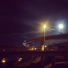 Is it a moon or a light pole? Is it a bridge or a river? Everything. . #moon #light #bridge #road #river #night #scenery #swiss #citylife #foundin #switzerland #dark #view