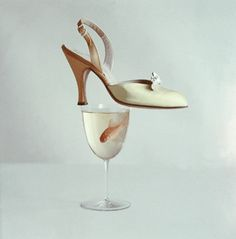 1953 Still life of yellow satin sling back with rhinestone buckle by Herbert Levine.