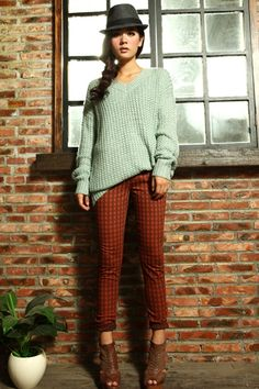 Sweater made of acrylic fiber, featuring V-neckline, long sleeves, all in loose fit.$57.2