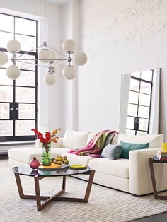 could easily represent this look with west elm product crosby sectional spindle coffee table astonishing home stores west elm