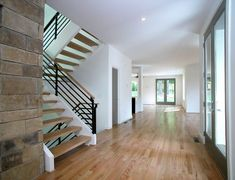 Modern Entryway with Custom contemporary wooden stair, Custom contempoary stair & railing by Gonen Liberman of Iron Creations