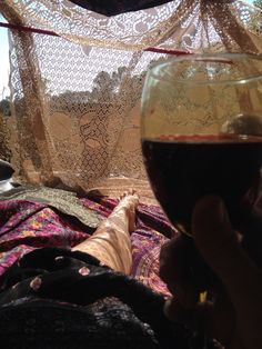Boho tent, red wine, blue skies, birds, pond, what more could a girl ask for