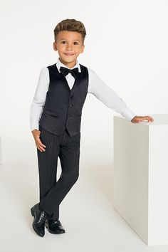 For a luxury look, the Oscar black waistcoat with grey striped trousers is a trendy take on a traditional tailoring. Styled with a subtly textured cufflink shirt, and coordinating bow tie, the outfit is a first class choice for any special occasion. Boys Black Shoes, Black Leather Shoes, Black Waistcoat, Plain White Shirt, Velvet Suit, Boys Suits, Page Boy, Black Trousers, Black Suits