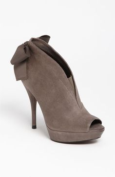 What an adorable Bootie, would be so cute with a pair of black skinny jeans tucked in and a taupe blouse, They can also be worn with the nighttime look- casual chic with-Vera Wang 'Royce' Bootie available at #Nordstrom