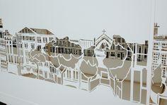 Paper cut outs exhibition at chq Dublin of facades of Dublin