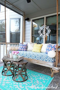 A vintage chic and very colorful back porch renovation featuring accessories from HomeGoods! A vintage porch swing, colorful pillows and rustic side tables make this a Southern dream! Sponsored by HomeGoods.