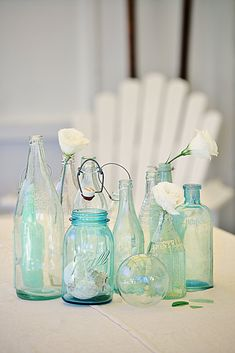vintage bottle decorating for a coastal vintage style feel  abeachcottage.com