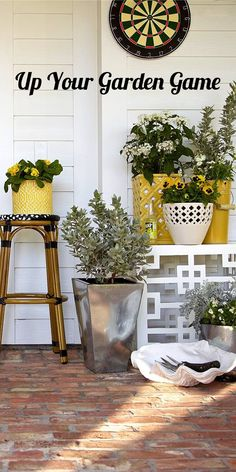 Get ready for the outdoors with functional and fun decor! These coordinating planters in yellows and metallics create a fresh cascade of greenery, also perched on side-tables and stools. Get creative with storage, like this over-sized sea shell to hold your potting tools!