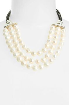 A pearl necklace will add a touch of elegance.