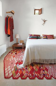 Beautiful jolts of color in a white room, and check out that rug!