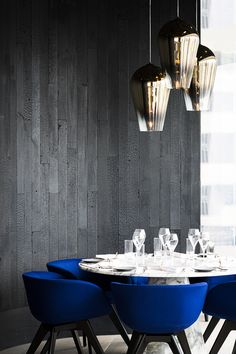 Under the creative direction of Tom Dixon, Design Research Studio has created the interiors for Alto, a new contemporary grill in Hong Kong. #blue #carrara #marble