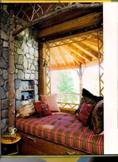 reading nook with tartan slip covers...nothing says Mountain home more than red fabrics!
