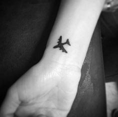 Tiny Black Airplane by Kayleigh Kerr