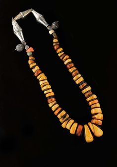 Africa | Old amber, silver, amazonite, coral and shell necklace from Morocco. Strung on leather | 1 200 € ~ sold
