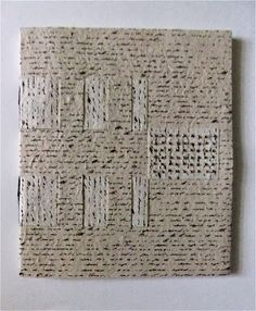 lovely crossed-structure binding book  by Kim Izenman  This gives me ideas of weaving textual paper of any sort for a cover.  How about it??