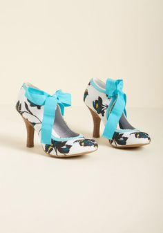 Ruby Shoo Garden Party Glam Heel in Turquoise - Vibrantly sketched vines in shades of teal, black, and yellow pop on the ivory background of this garden-party-perfect heel! Boasting turquoise and cream scalloped trim and a coordinating lace closure touting tassels, these stacked heels by Ruby Shoo will see that your style is always in full bloom!