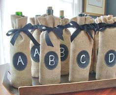 Jute Burlap Wine Bottle Bags to Custom Label over and over again - Set of 8. $36.00, via Etsy.