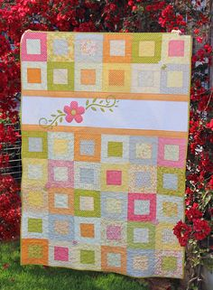 Adorable quilt -- could even skip/change the flower appliqué and do some other type of personalization (monogram, fairy, butterfly, etc). Could be changed to suit a boy, too.