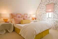 pink, yellow, white, soft and pretty with the textured rock wall :)