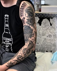 50 Traditional Tattoo Sleeve Designs You Need To See Traditional Tattoo Black And Grey, Traditional Tattoo Forearm, Traditional Tattoo Old School, Traditional Tattoo Design, Traditional Tattoo Sleeve Filler, Traditional Tattoo Back Piece, Dragon Sleeve Tattoos, Leg Sleeve Tattoo, Tattoo Sleeve Designs