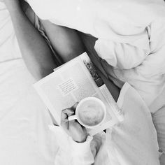 Reading , relaxing in bed .... Love lazy Saturday mornings!