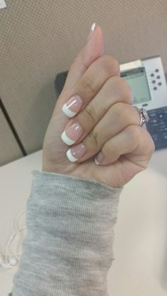 Classic french manicure with a dot of sparkle on the ring finger~