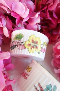A beautiful 1970's vintage set of custard cups in a sweet pansy design.