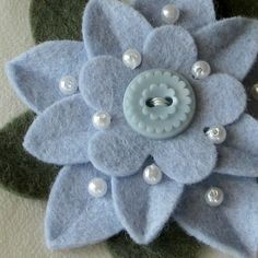 I like use of felt, buttons and pearls - maybe for button bouquets??