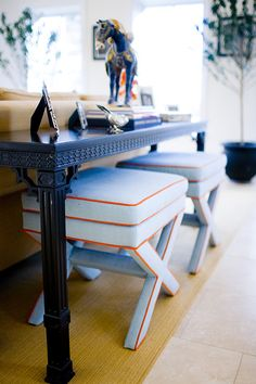 Mona Ross Berman Interiors » upholstered stools tucked under console; blue and orange benches