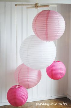 paper lantern mobile for above rocker in corner of room? orange, pink (light and hot), yellow, green and white. $45