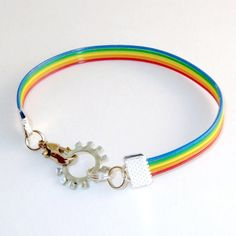 "Steampunk rainbow bracelet. And I quote, ""Gift for gays and lesbians."" Just slap a gear on it... those gays and lesbians will LOVE how steampunky they look. Sorry, but most steampunks and LGBTQ folks have a much better sense of style than this."