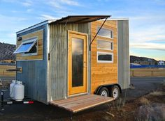 | Durango Tiny House |  A wood and metal-clad tiny house mounted to a trailer