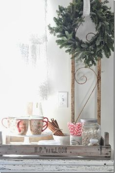 Farmhouse Christmas, fresh wreath, and a hot chocolate station in a French crate