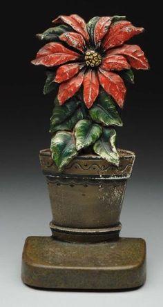 Lot # : 383 - Cast Iron Poinsettia Flower Doorstop.