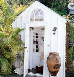 OK, this little white shed above and below is the perfect dreamy romantic backyard getaway.